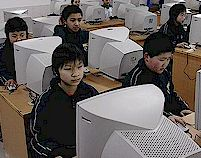 Students at the Liuyang Middle School in Liuyang, China work on computers.